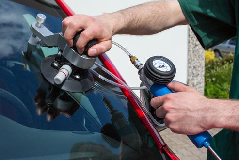 professional windshield repair vs. DIY repair kits